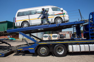 Taxis get loaded for transportation to Johannesburg